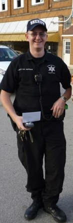 "Shown in this photo is Ben Huffman Gilmer County Sheriff Deputy who showed up with no warrant at the home of Ruth Mitchell who watched while Willard Cottrill was murdered by SISTER MORPHINE – Huffman, Sister Morphine, and Mike Murphy forced their way into the home and into Ruth's private bedroom where Huffman drew his weapon and then proceeded to help Sister Morphine and Murphy TOSS the room and search with no warrant. Ruth Mitchell Screamed, ""You can't do this!"" Huffman replied, ""There is nothing you can do about it,"" and then proceeded to talk to Ruth Mitchell worse than he would a stray dog! NO PERMISSION WAS GIVEN FOR THE SEARCH BUT THAT IS HOW THEY DO IT DOWN IN GILMER COUNTY!! The SS is currently seeking a meeting with HUFFMAN and deputy Wheeler about the incident, but we heard the matter was cleared by Mickey Metz himself, so no surprise there!"