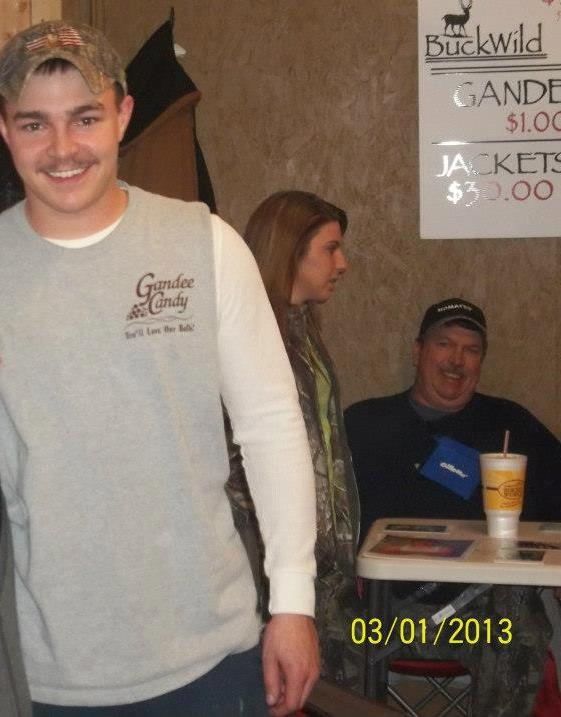 Shain at the Fleamarket in Milton with his dad Dale Gandee in the back at the table