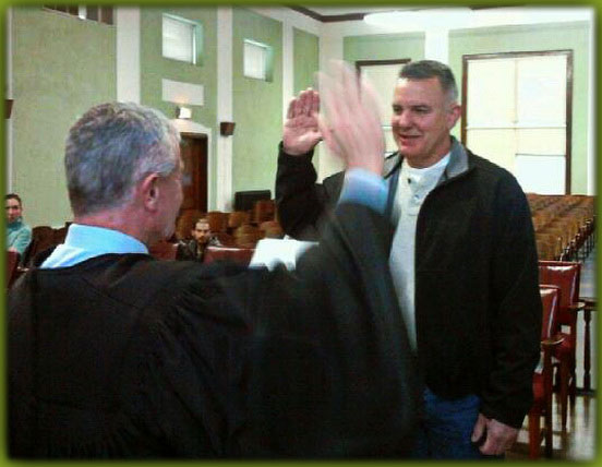 Judge Facemire in Gilmer County Circuit Court might as well be giving the HITLER SALUTE to Crooked County Commissioner Larry Chapman gettin a sworn into the CHURCH of IKE!!