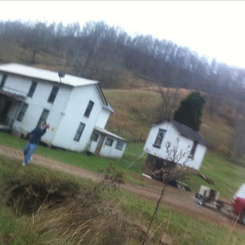 "Richard Neal is pictured in this photo moving in an aggressive and threatening way toward Marlea Cottrill and is flipping off and saying ""Fuck You..."" in this photo. Neal because of the corruption in Gilmer County was allowed to purchase this property without the estate even being settled and has threatened legal heirs of the property and has taken possession of much of the 40 plus acres know as the Willard Cottrill in estate in Linn down in Crooked County!!!"